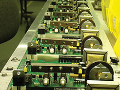 Printed circuit boards on assembly line