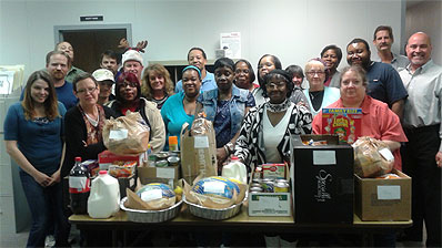 Carson employees with Thanksgiving food for families in need