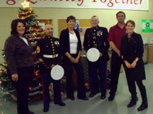 Carson employees with US Marine Corp Reserve officers