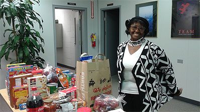 Mrs. Janet Muse with Thanksgiving food for families in need